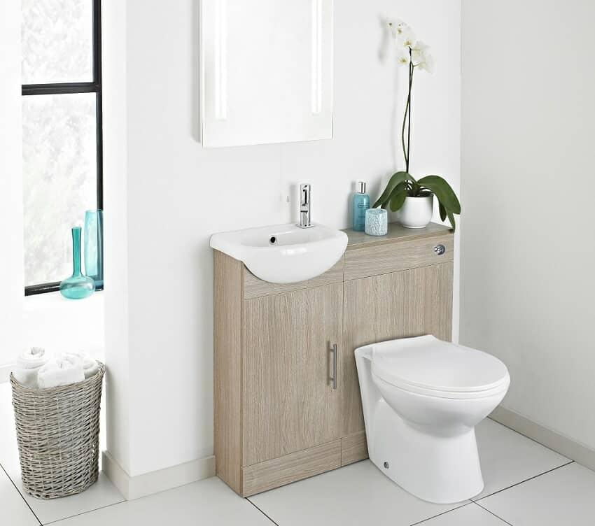 Maximiza el espacio de tu cuarto de baño con este conjunto de lavabo e inodoro, integrados en un mueble.